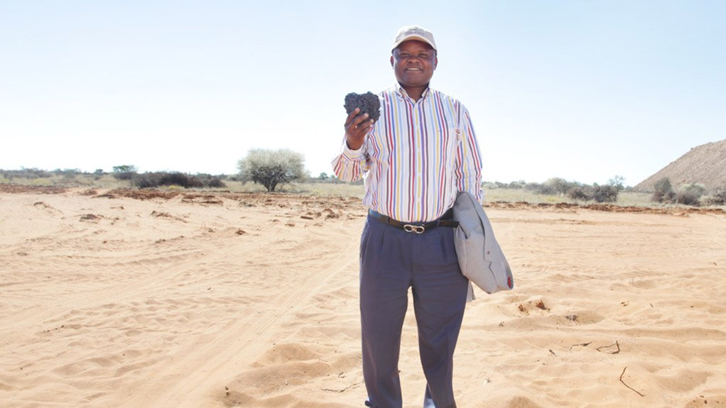 A flashback to 2003 when Ntsimbintle's Saki Macozoma, seen holding some of the hard grey manganese metal mined from the sands of Kalahari, turned the first sod at the Tshipi mine.