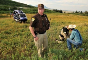 Checking out a rancher after a search mission. With Two Bear lending a helping hand, local law enforcement agencies now have the air support they once could have only dreamed of.